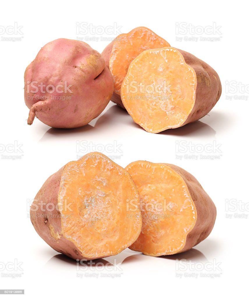 whole and halved sweet potatoes stock photo