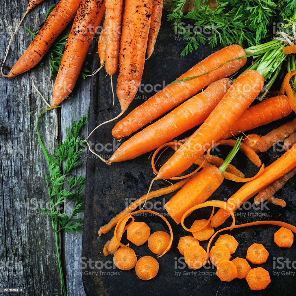 Whole and sliced carrots stock photo