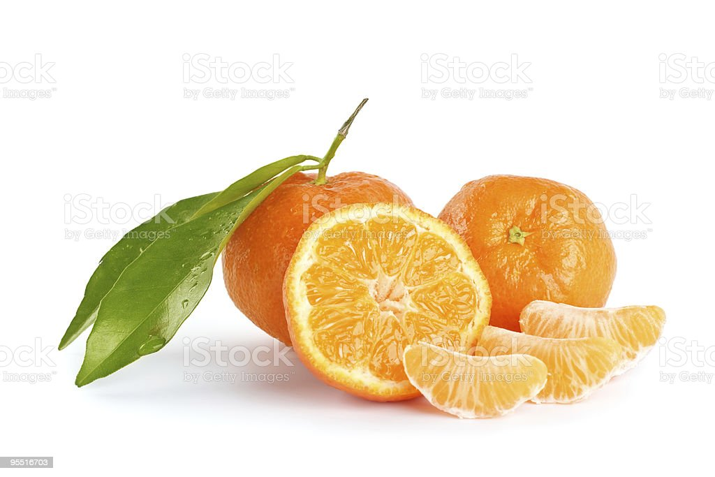 Whole and sliced mandarins on a white background stock photo