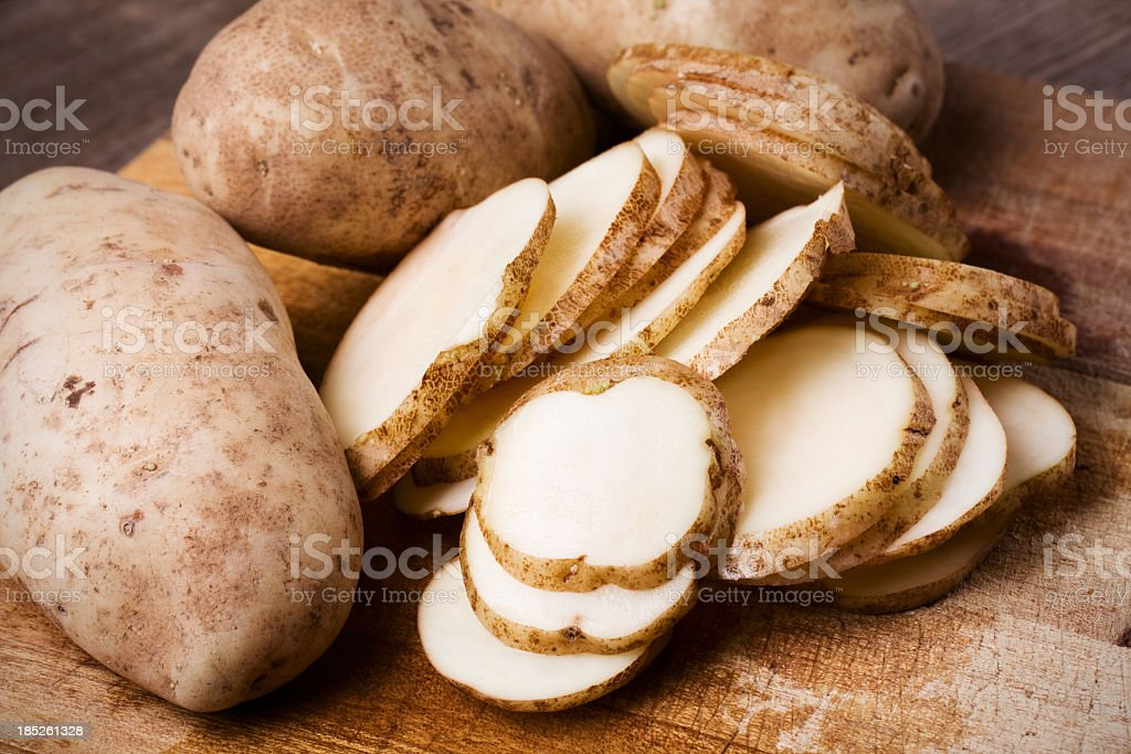 Whole and Sliced Russet Potatoes stock photo