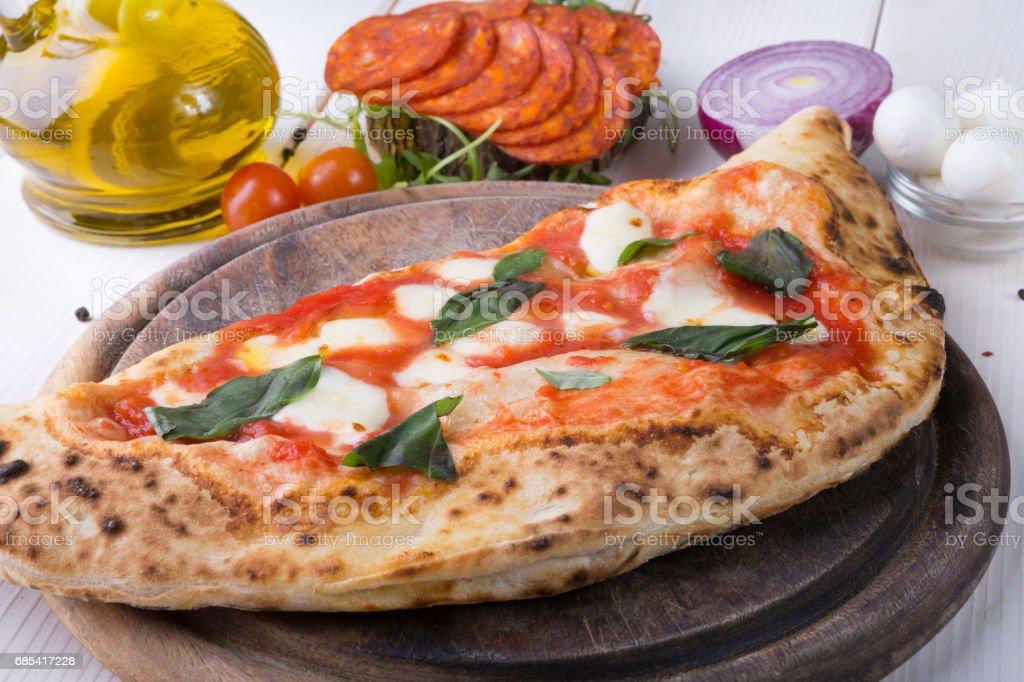 Whole baked pizza stock photo