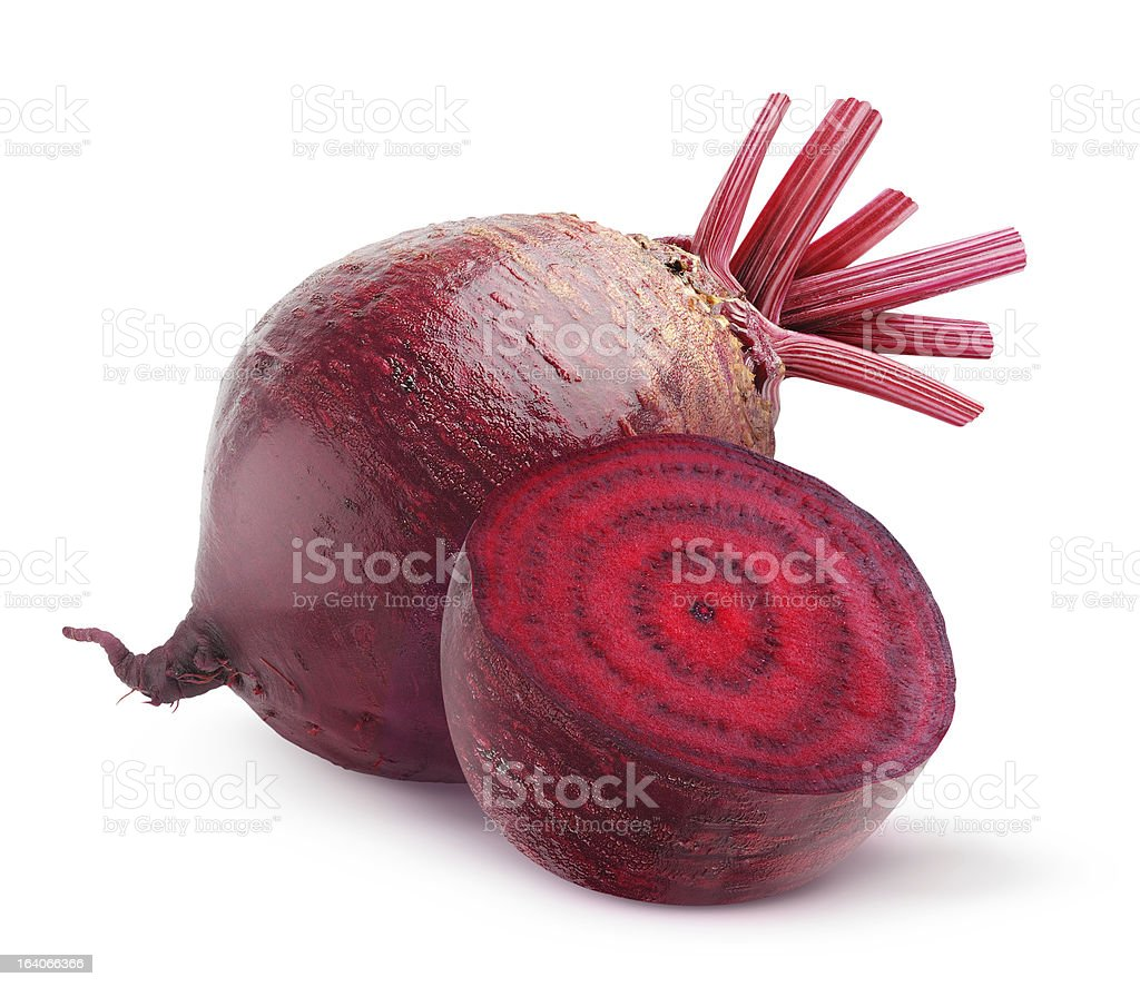Whole beetroot next to one cut in half on a white background stock photo