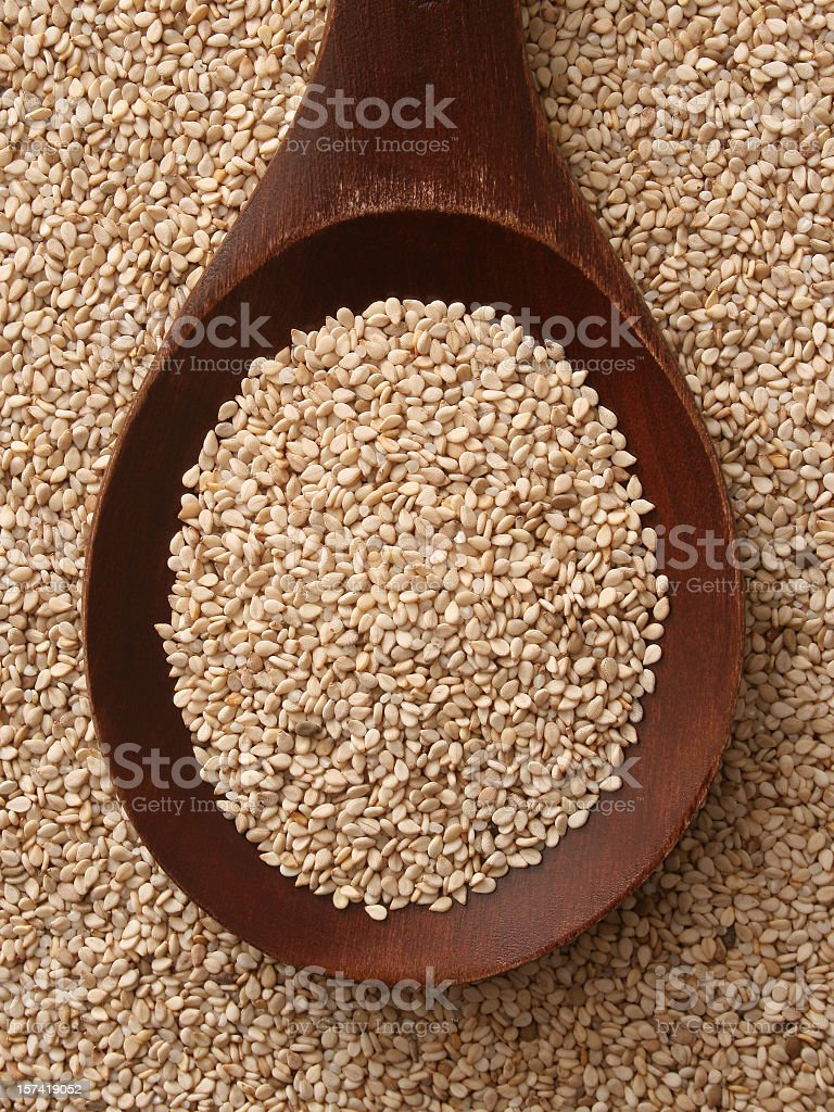 Whole brown sesame seeds royalty-free stock photo