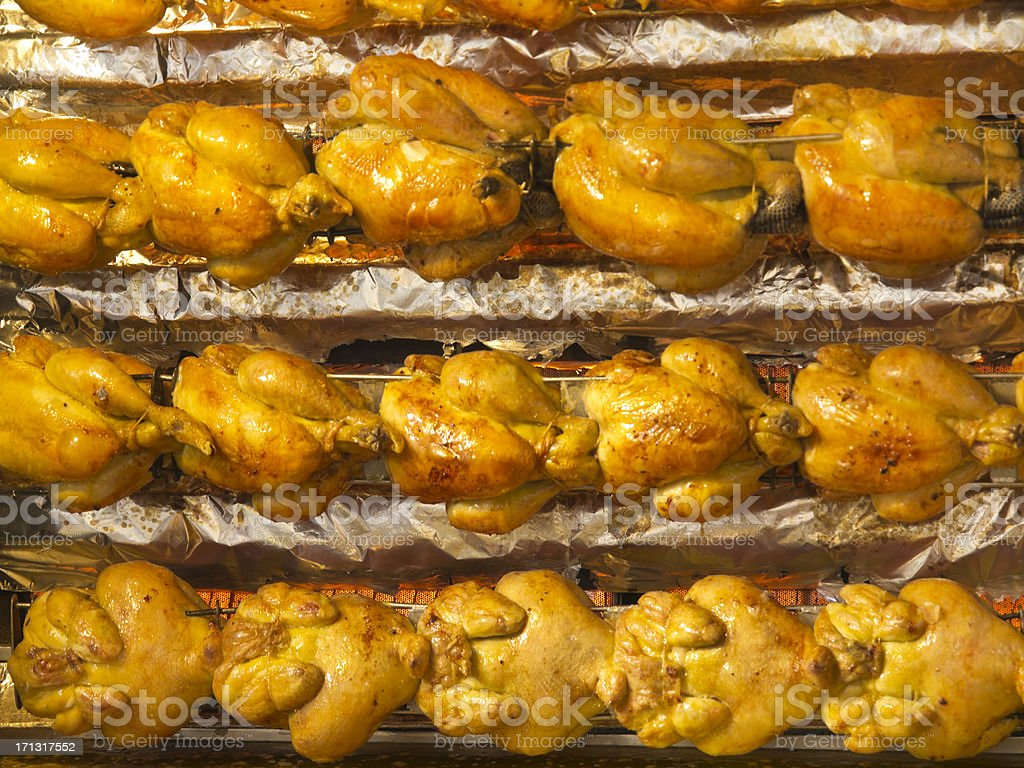 Whole chickens on rotisserie. stock photo