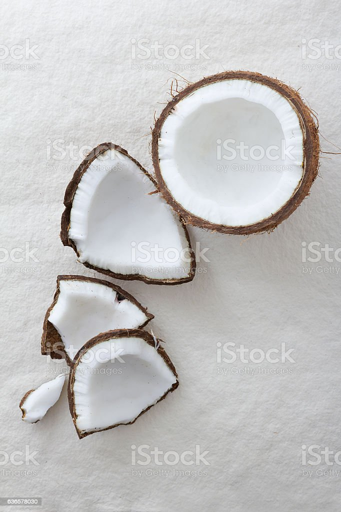 Whole coconut cracked open stock photo