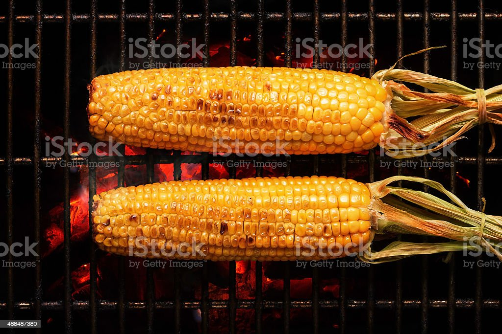 Whole Corn on grill stock photo