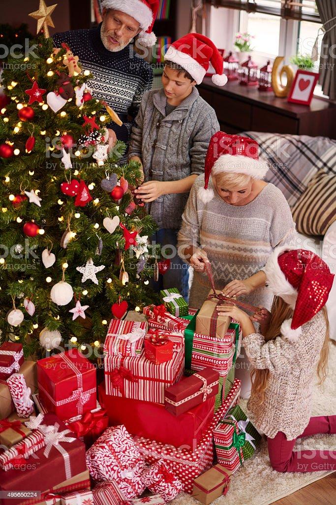 Whole family around the Christmas tree stock photo