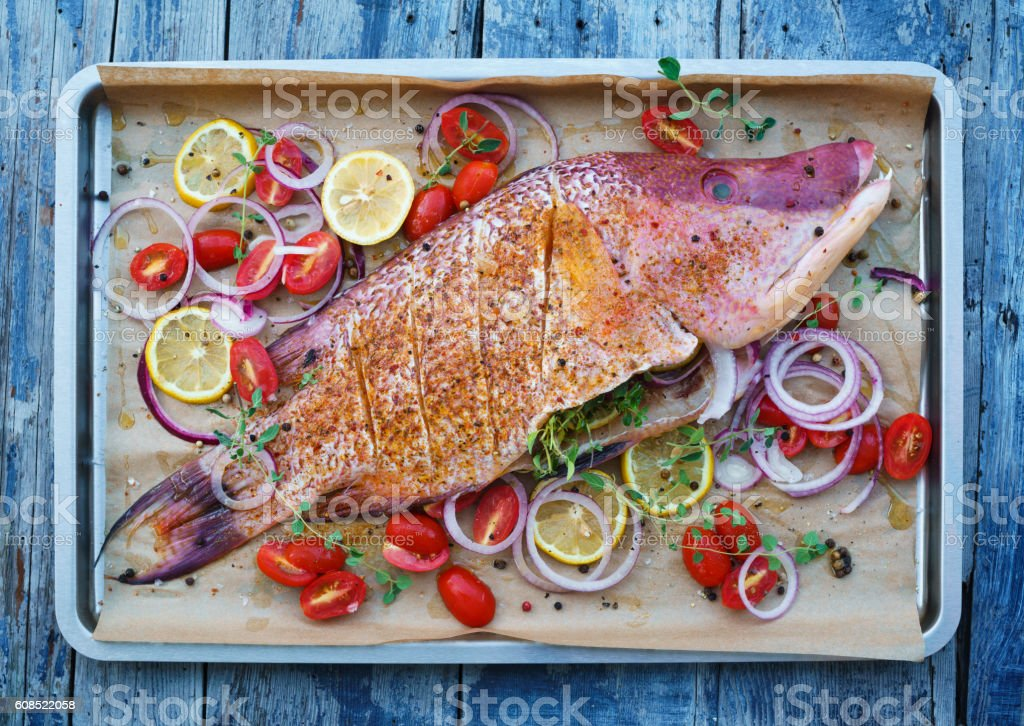 Whole fish ready for the oven stock photo