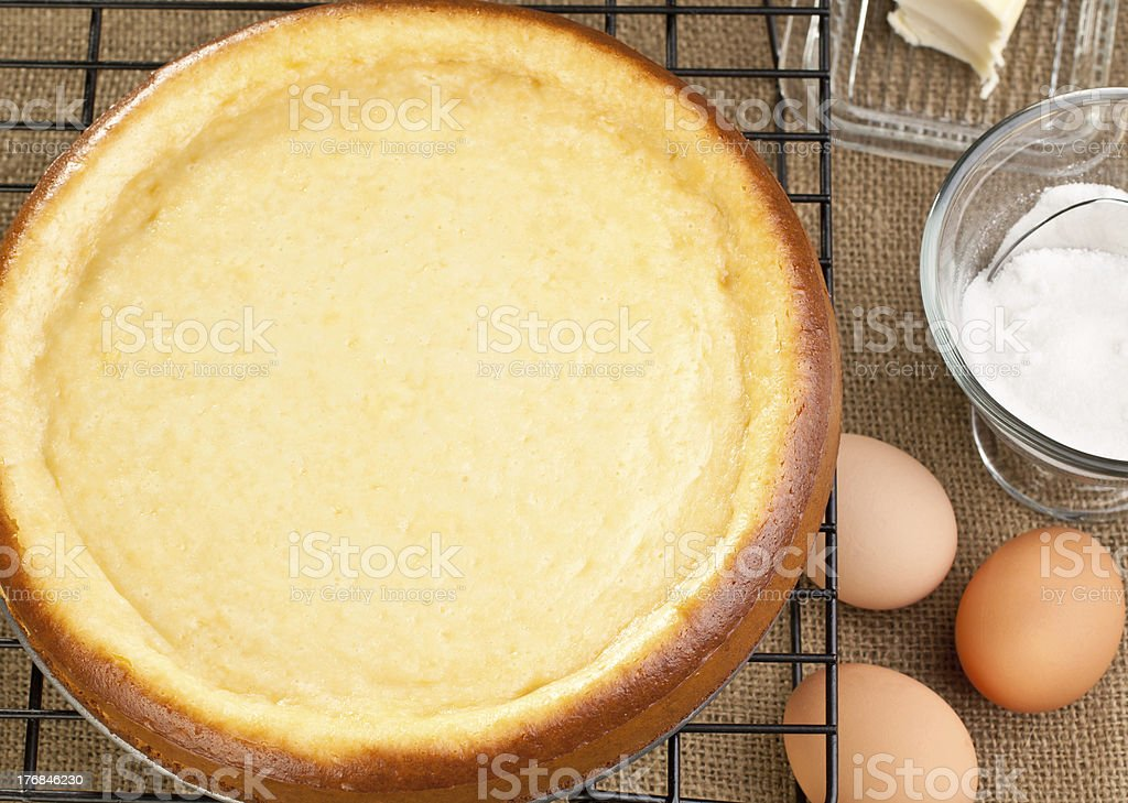 Whole fresh cheesecake with it's ingredients stock photo