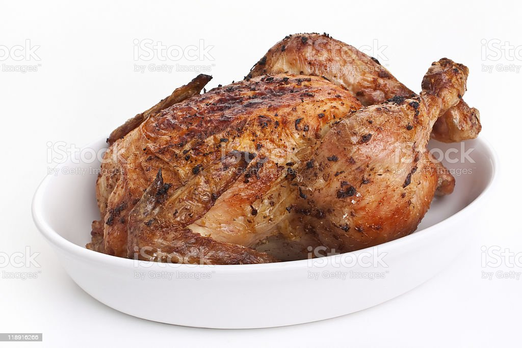 whole golden roasted chicken stock photo