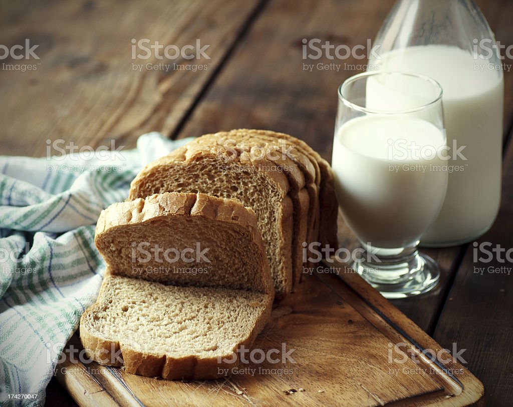 Whole grain bread with a glass of milk stock photo