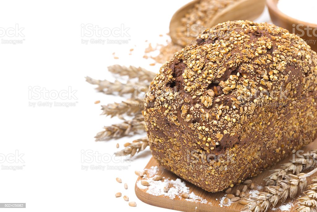 whole grain bread with seeds, wheat and flour, isolated stock photo