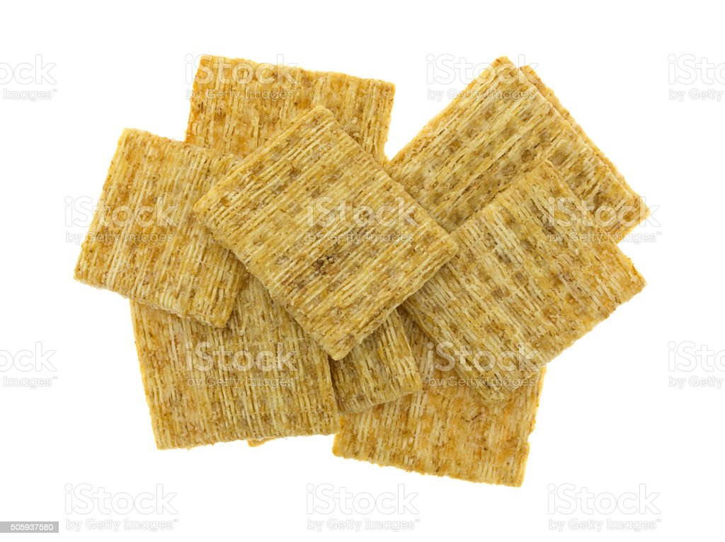 Whole grain crackers on a white background stock photo