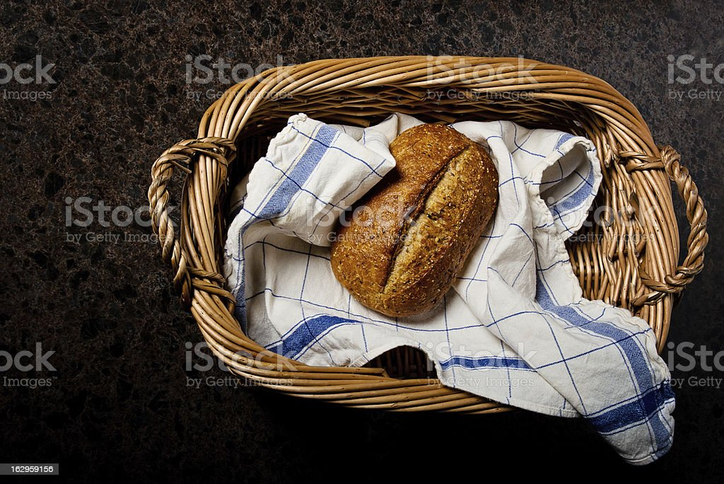 Whole Grain Loaf of Bread in Basket royalty-free stock photo