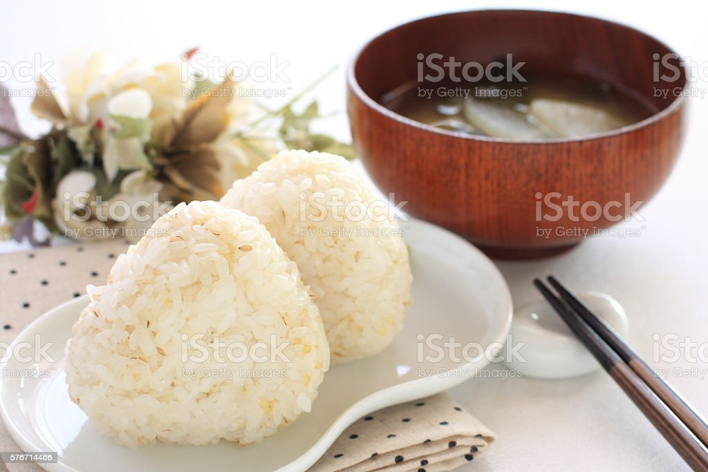 whole grain rice ball with soup stock photo