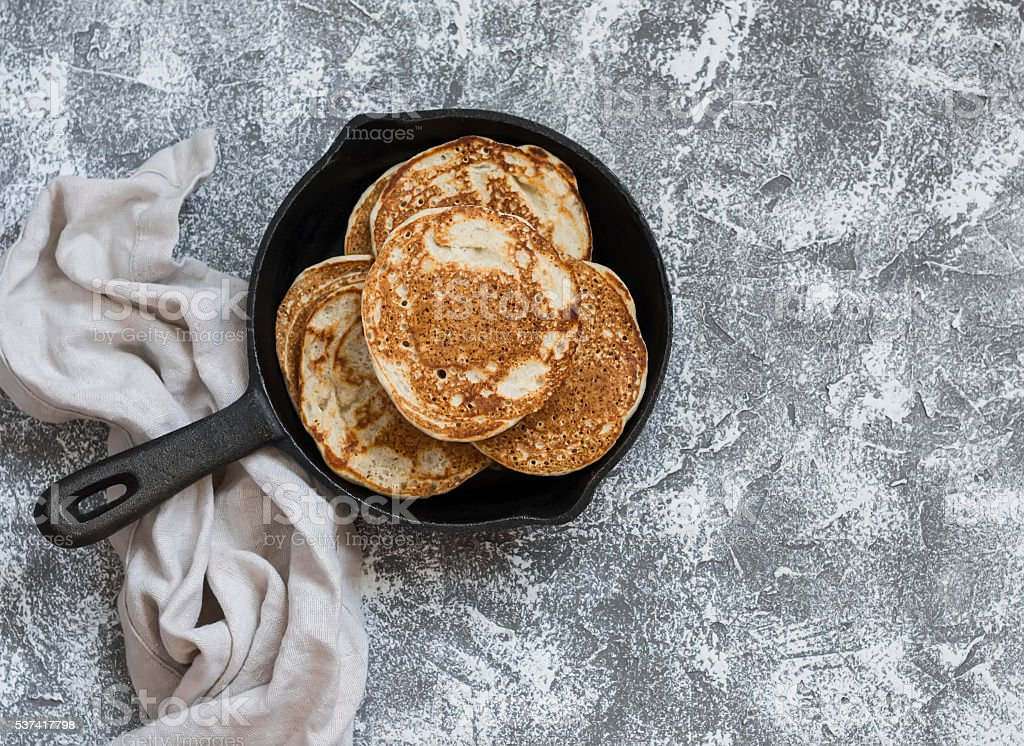Whole grain vegan pancakes in a cast iron pan stock photo