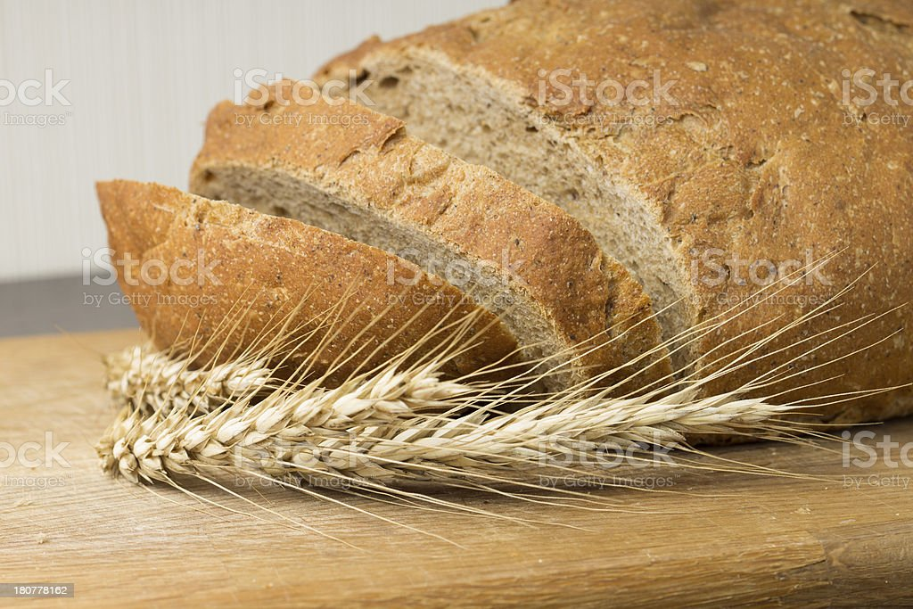 Whole grain wheat bread with ears royalty-free stock photo