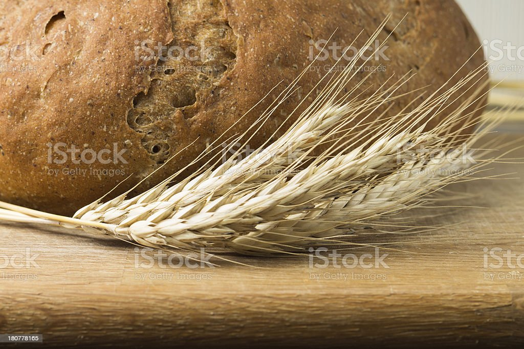 Whole grain wheat bread with spikelets royalty-free stock photo
