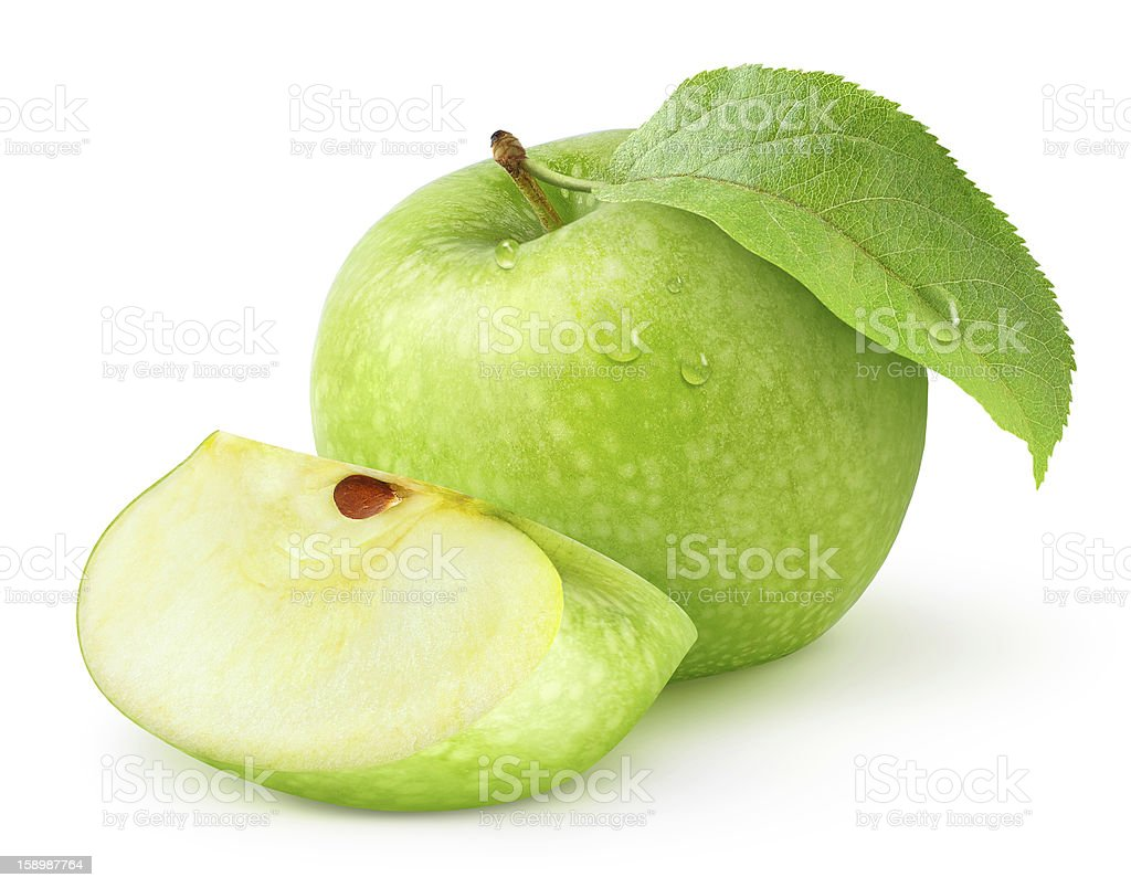 A whole green apple with a leaf and a apple slice stock photo