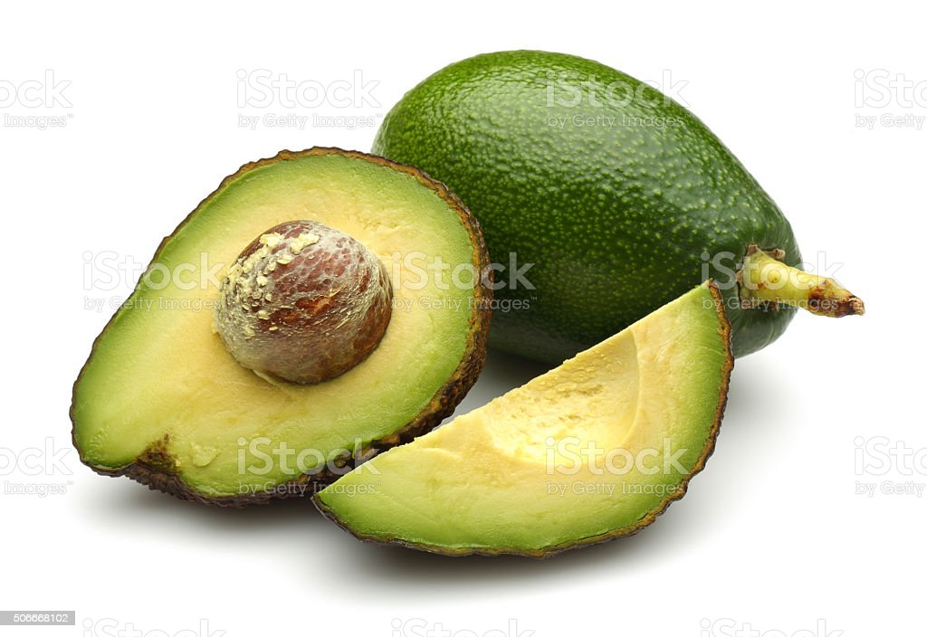 Whole, Half and quarter slice avocados stock photo