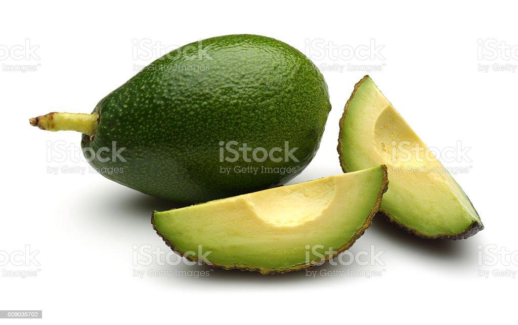 Whole, Half and quarter slice avocados stock photo