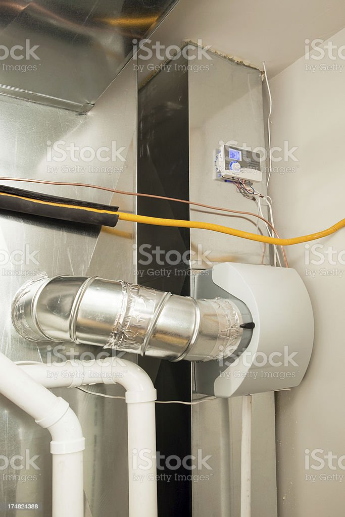 Whole House Humidifier Installed on Furnace Duct stock photo