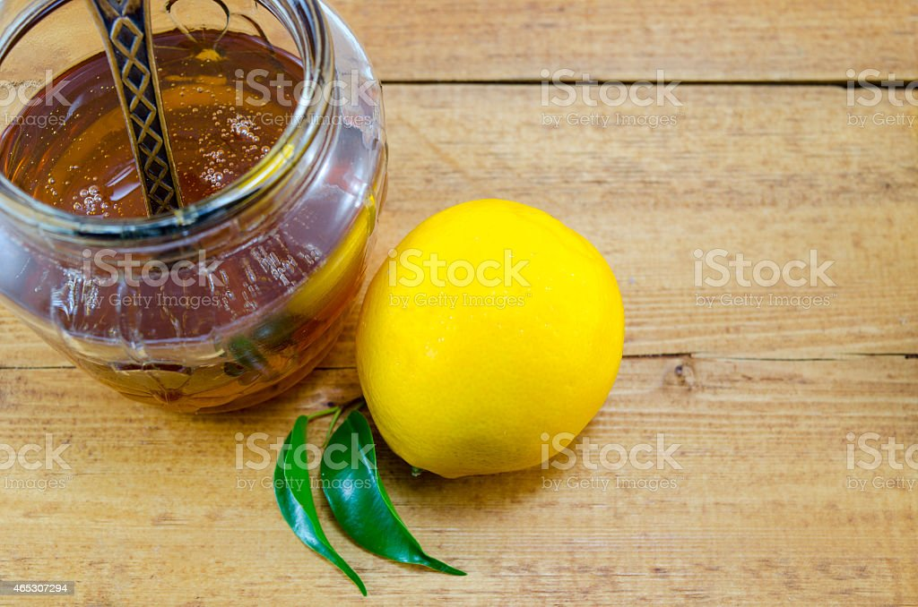 Whole lemon and honey in a jar royalty-free stock photo
