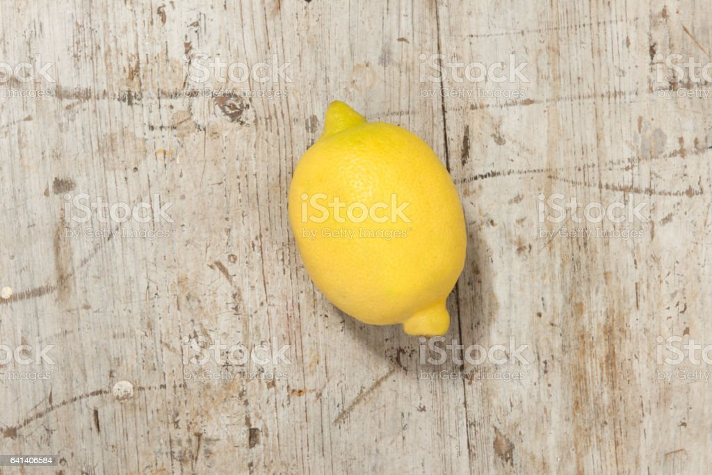 Whole Lemon on a Wooden Background stock photo