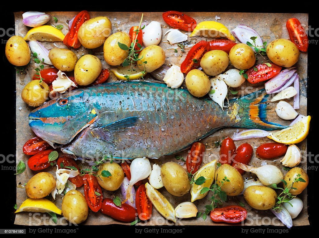 Whole parrot fish ready for the oven stock photo