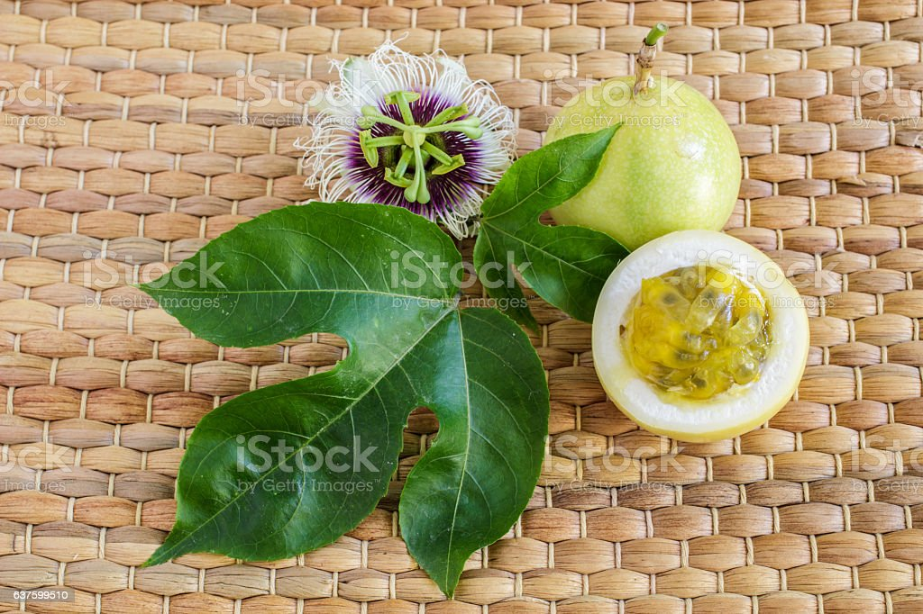 Whole passion fruit with slice, passion fruit flower stock photo