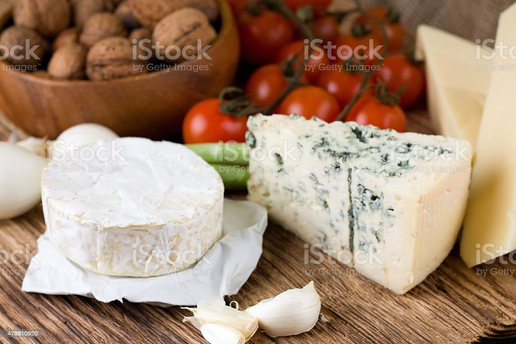 Whole portion of camembert with other kinds of cheese stock photo