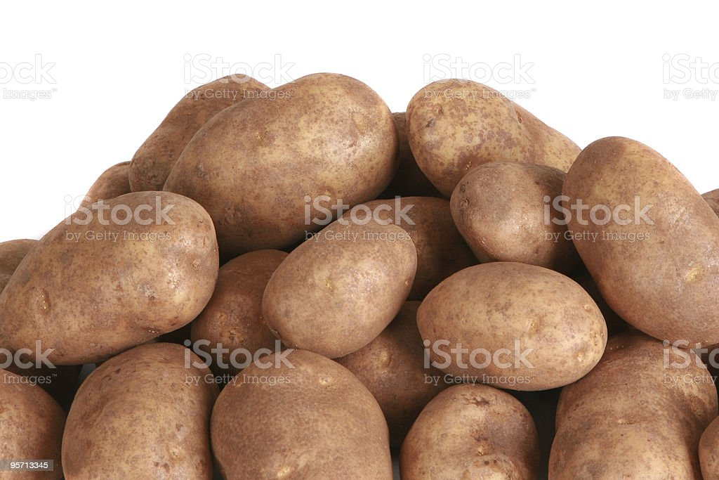 Whole potatoes isolated on a white background stock photo
