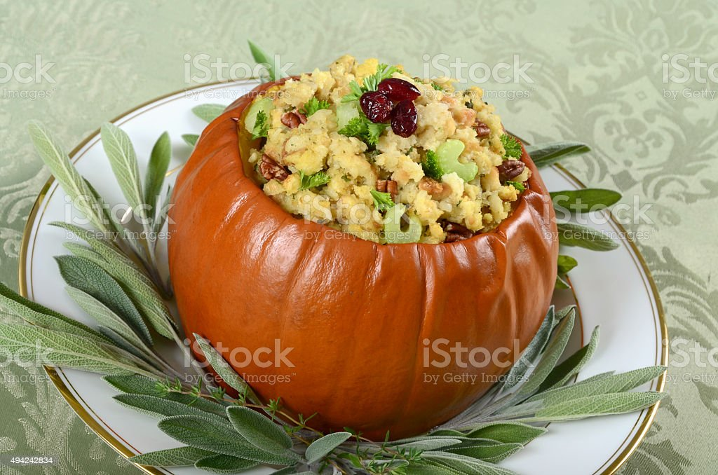 Whole Pumpkin With Bread and Herb Stuffing for Thanksgiving stock photo