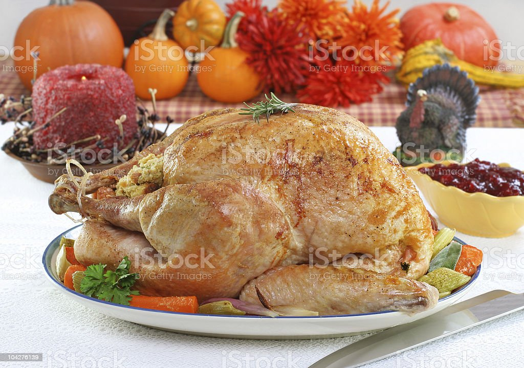 Whole roasted turkey in Thanksgiving setting. royalty-free stock photo