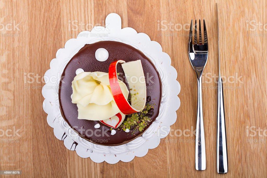 Whole Round Cake and Slice on Wood Table stock photo