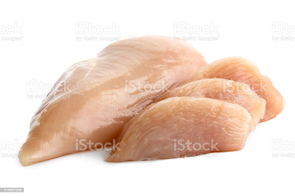 Whole skinned deboned raw chicken breast isolated on white. stock photo