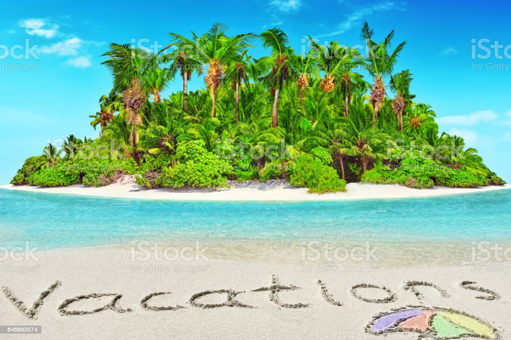 Whole tropical island within atoll in tropical Ocean and inscription 'Vacations' in the sand on a tropical island. stock photo