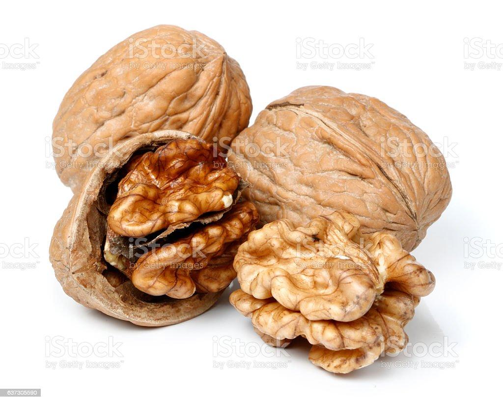 Whole walnut and half walnut piece. stock photo