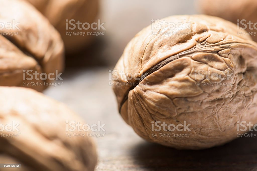 Whole walnuts in shells close up with selective focus stock photo