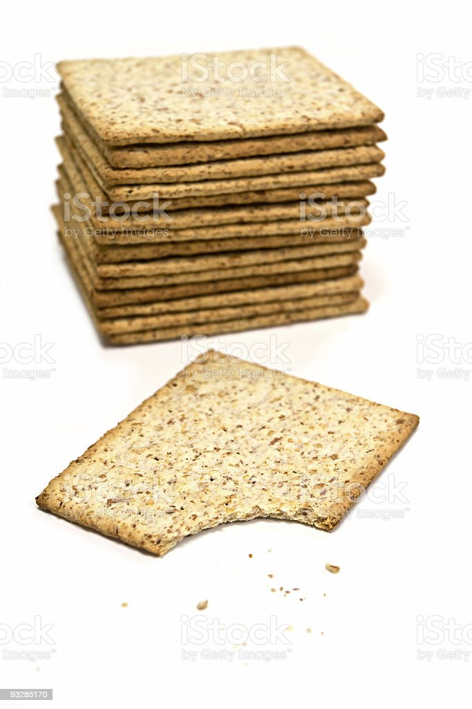 whole wheat biscuits isolated on white royalty-free stock photo