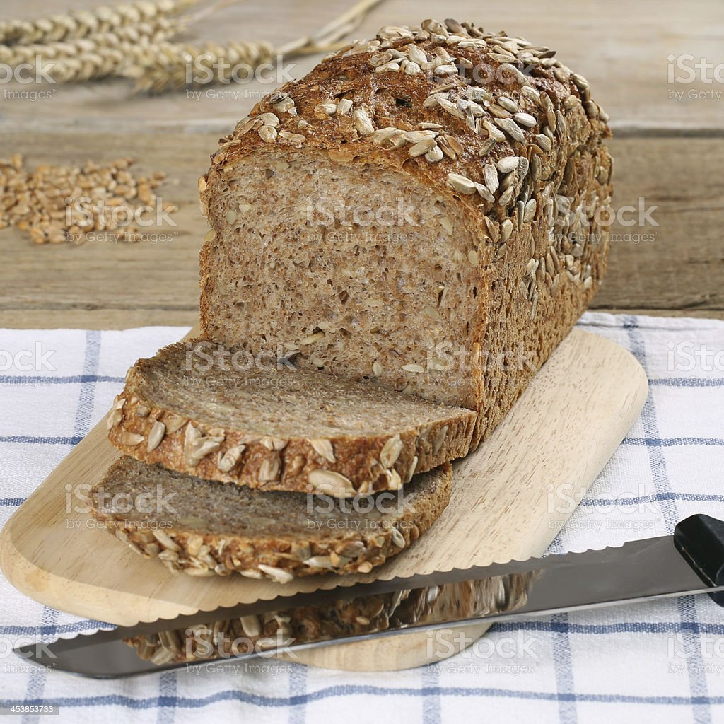 Whole wheat bread on a wooden board royalty-free stock photo
