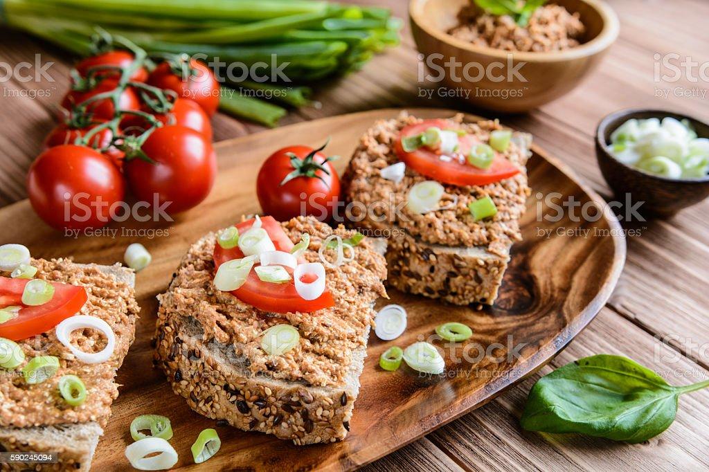 Whole wheat bread with fish spread, tomato and onion stock photo