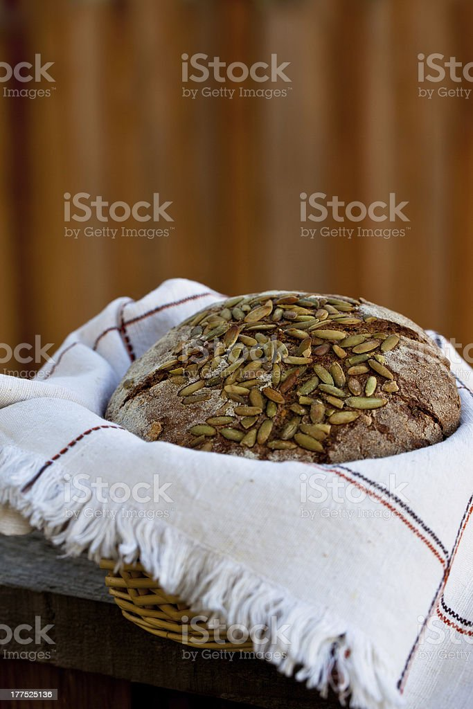 Whole wheat bread with pumpkin seeds in the basket. royalty-free stock photo