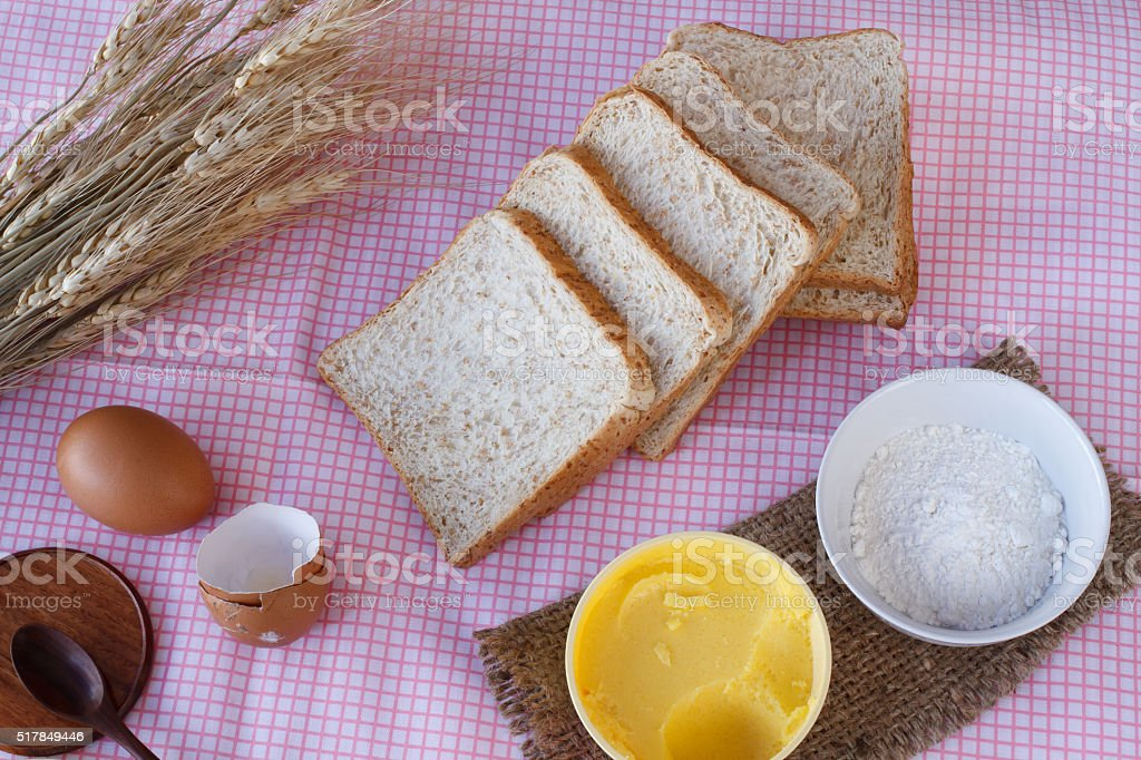 Whole wheat bread,egg,magarine,flour and wheat stock photo