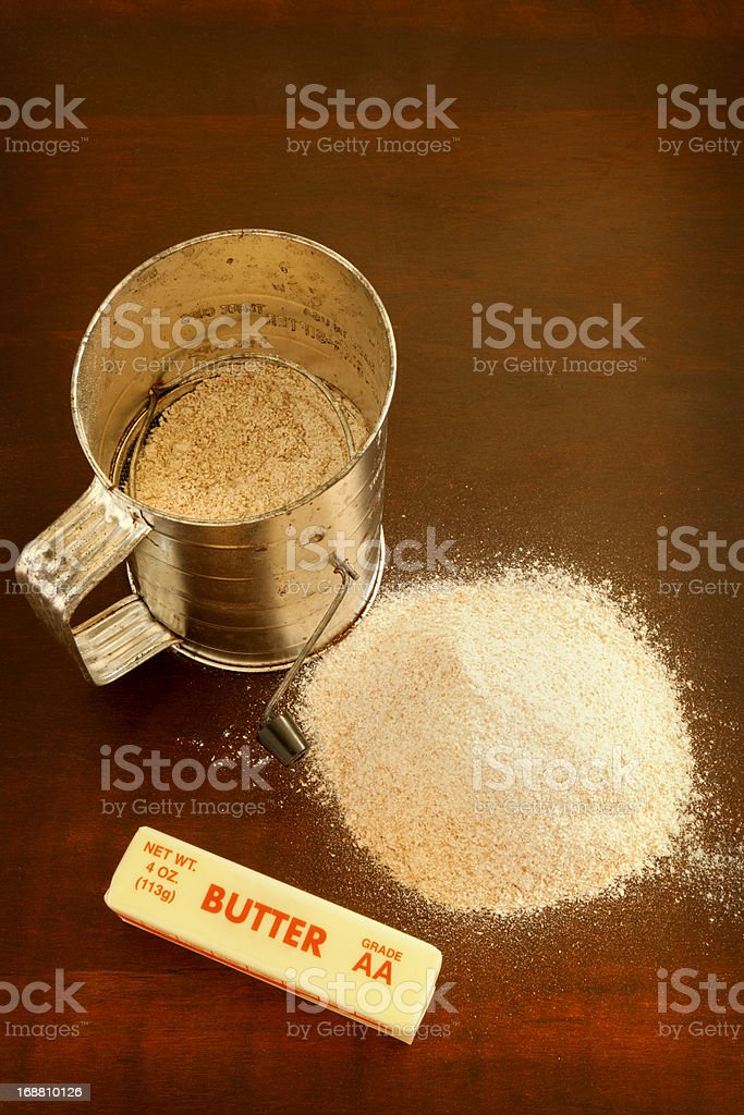 Whole Wheat Flour Butter and Old Sifter royalty-free stock photo