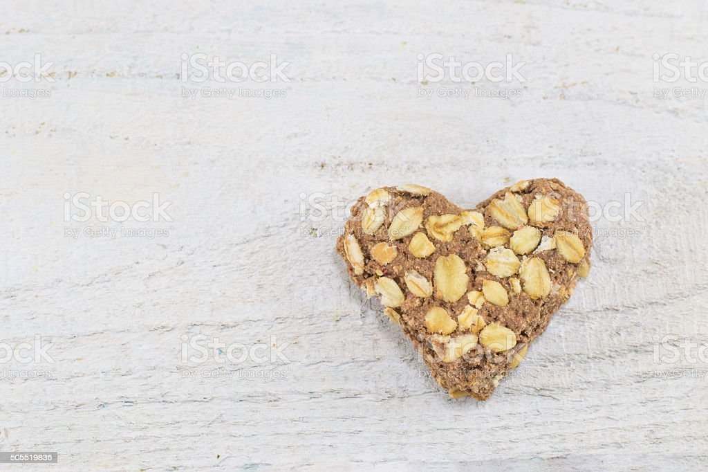 whole wheat flour heart filled with seeds stock photo