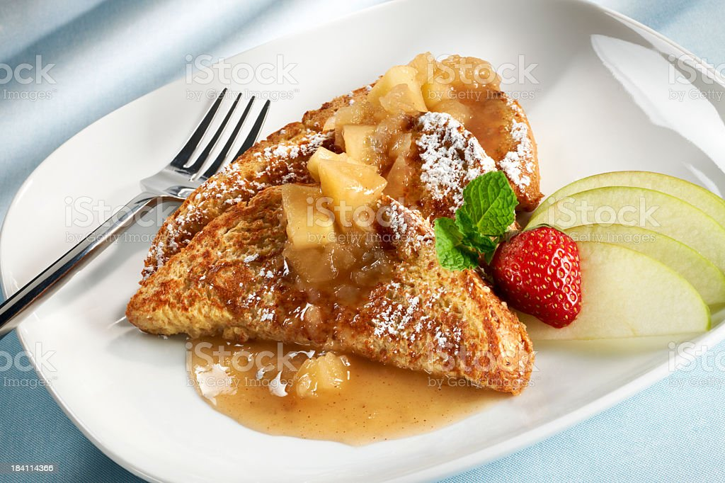 Whole wheat french toast with apples and a strawberry stock photo