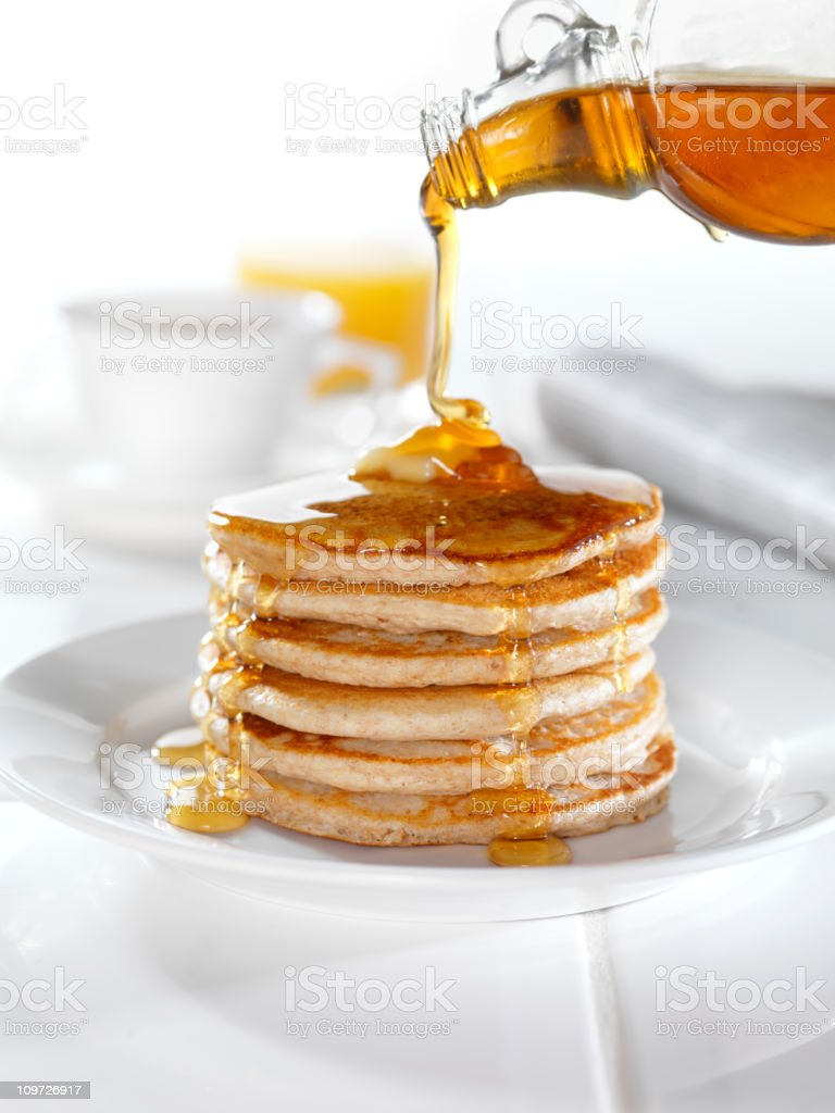 Whole Wheat Pancakes with Maple Syrup stock photo