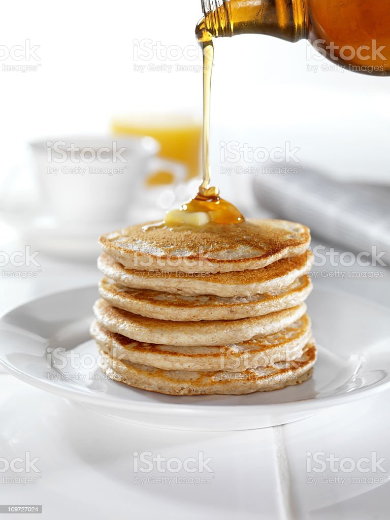 Whole Wheat Pancakes with Syrup and Butter royalty-free stock photo