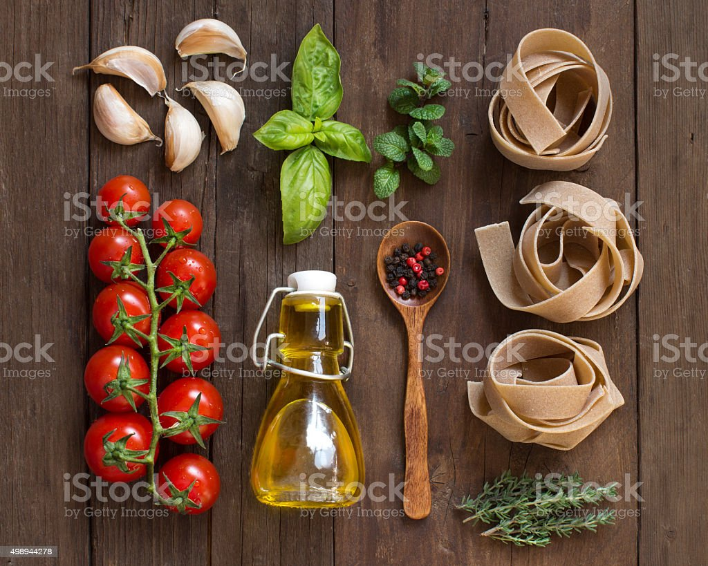 Whole wheat  pasta, vegetables,  herbs and olive oil stock photo